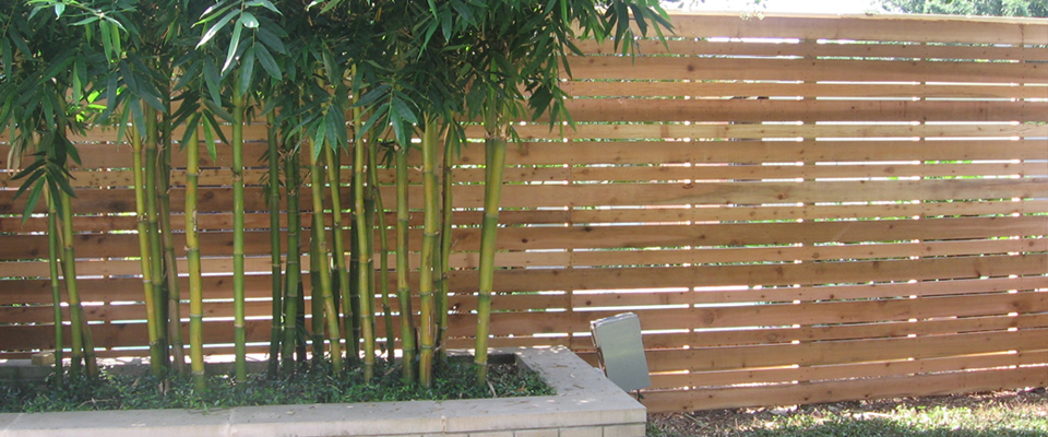 Slat wood fence